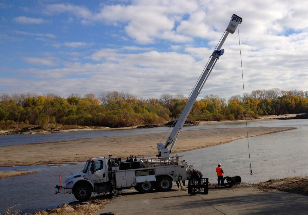 Westar's line truck pulling debris from down river!