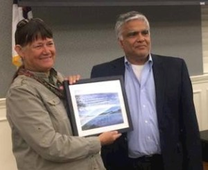 Laura receives the Bill Ward Award from Ashok Gupta, KNRC Board Member